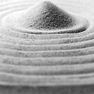 Pile of sand on raked sand by christopherjl