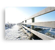 snow covered fenced path on cliff edge walk Canvas Print