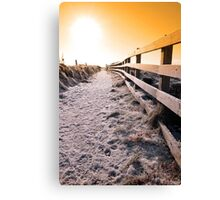 snow covered frozen path on cliff fenced walk at sunset Canvas Print
