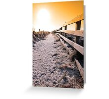 snow covered frozen path on cliff fenced walk at sunset Greeting Card