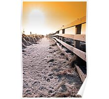 snow covered frozen path on cliff fenced walk at sunset Poster