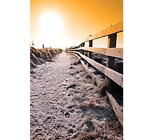 snow covered frozen path on cliff fenced walk at sunset Photographic Print