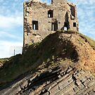 Ballybunion castle ruin on a curvy rock face by morrbyte