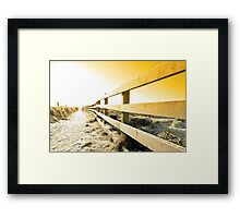 snow covered freezing path on cliff fenced walk at sunset Framed Print