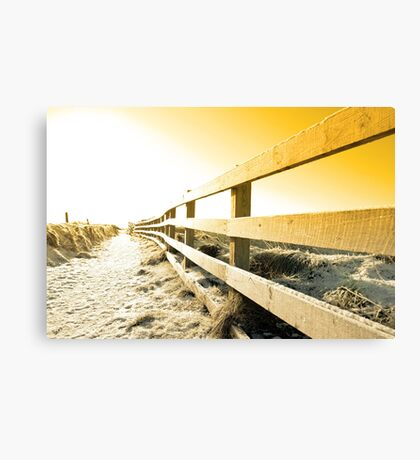 snow covered freezing path on cliff fenced walk at sunset Canvas Print