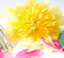 knife and fork isolated with dahlia and rose petals by morrbyte