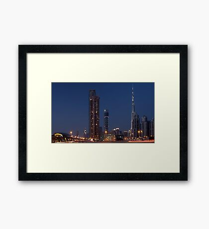 Rushing home from Business Bay Framed Print
