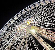 Ferris wheel at night by EmilFingal
