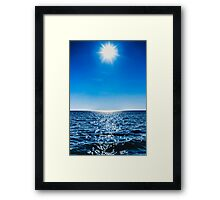 Sun, water, sky Framed Print
