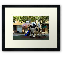 Playgroung cow Framed Print