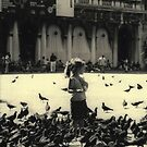Little girl and pigeons in Venice, Italy by Elana Bailey