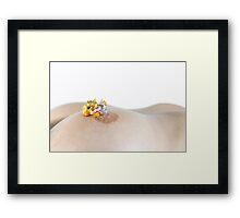 miniature toy measuring woman's nipple  Framed Print