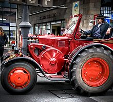 Vintage tractor on market day,  by PhotoStock-Isra