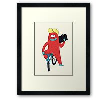 Cyclop monster on a bicycle Framed Print