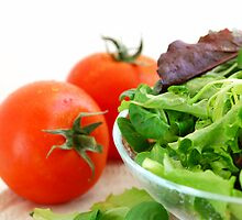 Baby greens and tomatoes by photolcu