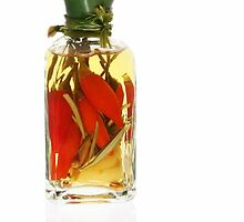 Oil Infused with Red Chilli Peppers by photolcu