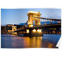 The Chain Bridge in Budapest lit by the street lights Poster