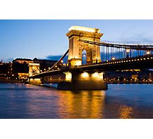 The Chain Bridge in Budapest lit by the street lights Photographic Print