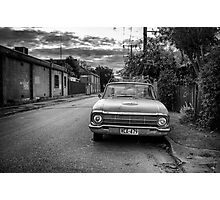 An old cars is left to decay in the backstreets of Adelaide. Photographic Print