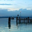 Lake Garda Pier and the Last Ferry for the day by kirilart