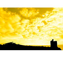 silhouette of a crowd on a hill beside old castle Photographic Print