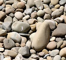 River Rocks Pebbles by Henrik Lehnerer
