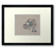 Two men walking one carrying a shoulder pole with barrel like containers the other carries a long handled mallet 001 Framed Print