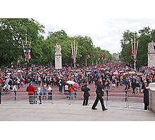 Crowds walk down the mall after Trooping The Colour to watch the Royals on the balcony Photographic Print
