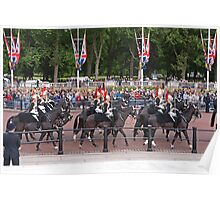 Soldiers pass Queen Victorias Memorial statue before Trooping The Colour Poster