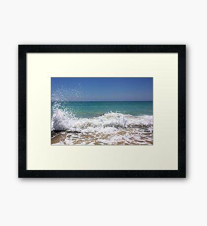 Waves crashing on the rocks Framed Print