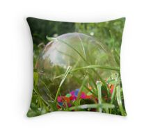 Ball in the grass Throw Pillow
