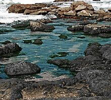 Black Rocks on Blue Water by ibadishi