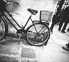 a bicycle on a parisian street by Paula Burgoon