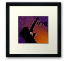 Silhouette of a Rock Singer with Purple and Orange Background Framed Print