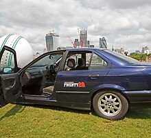 Friends Life T20 car with a cricket ball on its bonnet  by Tower Bridge  by Keith Larby