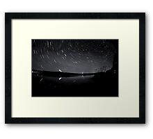 Star trails over the lake Framed Print