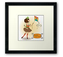 cute teens who are playing with a kite Framed Print