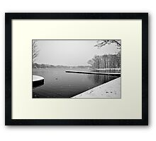 Snowing on the Dock (In the Lake) Framed Print