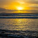 beautiful yellow sunset and soft waves at beal beach by morrbyte