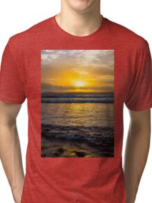 beautiful yellow sunset and soft waves at beal beach Tri-blend T-Shirt