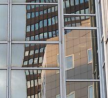 Reflection in skyscraper windows by UpNorthPhoto