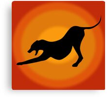 Silhouette of a Stretching and Yawning Dog on Orange Background Canvas Print