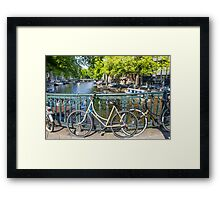Amsterdam canal and bikes Framed Print