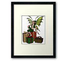 Christmas Fairy Elf Boy Sitting on a Pile of Presents Framed Print