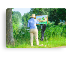 Paintress of Flemish summer landscape at work in the field Canvas Print