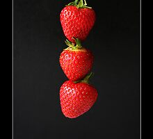 Strawberries On Black Labeled by Alan Harman