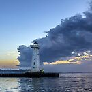 Sunset Clouds Greet The Lighthouse by Mikell Herrick