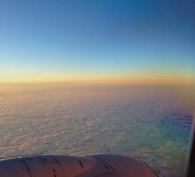rainbow from an airplane by shoshgoodman