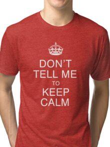 Don't tell me to keep calm Tri-blend T-Shirt