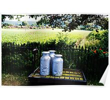 Milk canisters on a cart. Poster
